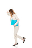 Tired businesswoman with binder. Royalty Free Stock Photography