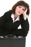 Tired Businesswoman with Briefcase Royalty Free Stock Photography