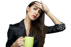 Tired businesswoman with a cup Royalty Free Stock Photography
