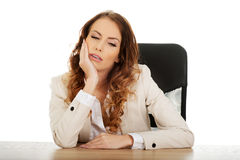 Tired businesswoman at the desk. Royalty Free Stock Photography