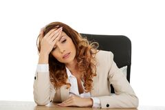 Tired businesswoman at the desk. Royalty Free Stock Photo