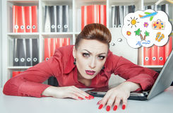 Tired businesswoman dreaming about holiday. Overwork concept Stock Photos