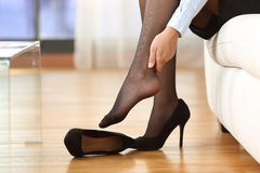Tired businesswoman feet pain Royalty Free Stock Image