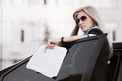 Tired businesswoman with financial reports Royalty Free Stock Image