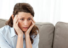 Tired businesswoman having a headache on the sofa Royalty Free Stock Image