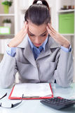 Tired businesswoman having a headache while working on paperwork Stock Image