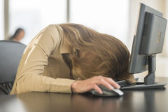 Tired Businesswoman With Head On Keyboard stock photo