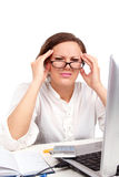 Tired businesswoman holding her head Royalty Free Stock Photo