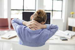 Tired businesswoman holding her nape Stock Images