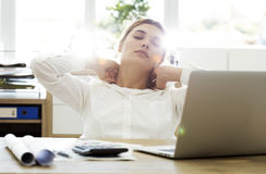 Tired businesswoman holding her nape Royalty Free Stock Images