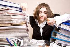 Tired businesswoman with a lot of folders. And telephones royalty free stock photography