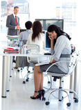 Tired businesswoman in a meeting royalty free stock photo