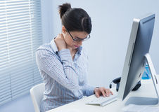 Tired businesswoman with neck pain Royalty Free Stock Photos