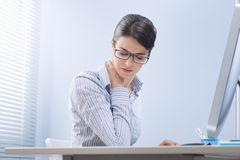 Tired businesswoman with neck pain royalty free stock photography