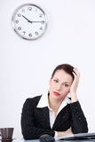 Tired businesswoman in the office. Stock Image