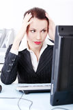 Tired businesswoman in the office. Royalty Free Stock Images
