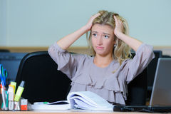 Tired businesswoman at the office Royalty Free Stock Photo
