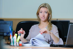 Tired businesswoman at the office Stock Photo
