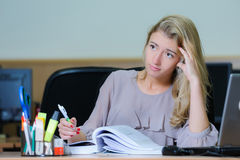 Tired businesswoman at the office Stock Image