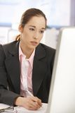 Tired businesswoman at work Stock Photography
