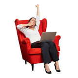 Tired businesswoman sitting in red chair Royalty Free Stock Photos