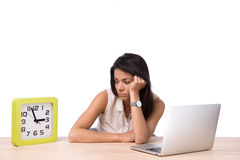 TIred businesswoman sitting at the table Stock Photo