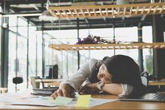 Tired businesswoman sleep at office. exhausted woman dozing at w. Young tired businesswoman sleep at office. exhausted woman dozing at workplace. overwork Stock Photography