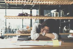 Tired businesswoman sleep at office. exhausted woman dozing at w. Young tired businesswoman sleep at office. exhausted woman dozing at workplace. overwork stock image
