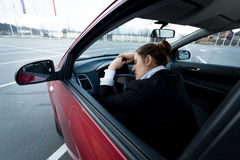 Tired businesswoman sleeping in car Royalty Free Stock Image