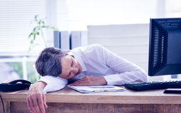 Tired businesswoman sleeping at her desk Stock Photography