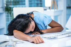 Tired businesswoman sleeping at her desk Royalty Free Stock Photography
