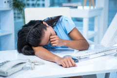 Tired businesswoman sleeping at her desk Royalty Free Stock Photo