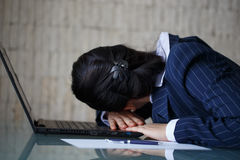 Tired businesswoman sleeping on laptop Stock Photography