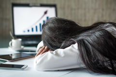 Tired businesswoman sleeping in office. Overtime Stock Images