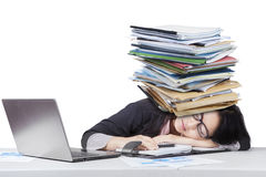 Tired businesswoman sleeping with paperwork Royalty Free Stock Image