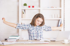 Tired businesswoman stretching arms Royalty Free Stock Photo