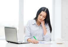 Tired businesswoman or student with laptop Royalty Free Stock Image