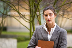 Tired businesswoman or student outside. Tired businesswoman or student looking at camera, outdoor Stock Photos