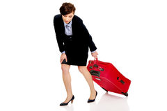 Tired businesswoman with suitcase. Royalty Free Stock Images