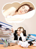 Tired businesswoman  with a lot of folders dreaming Stock Photos
