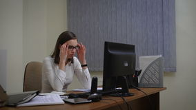 Tired businesswoman under a lot of stress using computer
