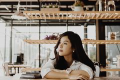 Tired businesswoman wake up after sleep at office. exhausted woman dozing at workplace. overwork, fatigue concept. Young tired businesswoman wake up after sleep royalty free stock photo