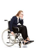 Tired businesswoman on a wheelchair Royalty Free Stock Photo