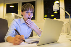 Tired businesswoman working late in office Stock Photography