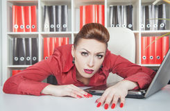 Tired businesswoman working in office. Overwork concept Stock Photography