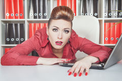 Tired businesswoman working in office. Overwork concept Royalty Free Stock Images