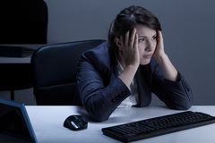 Tired businesswoman working overtime. Horizontal view of tired businesswoman working overtime Royalty Free Stock Photos