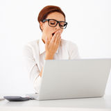 Tired businesswoman yawning Stock Image