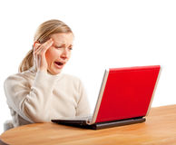Tired businesswoman yawning. Tired businesswoman sitting infront of her laptop and yawning (isolated on white Stock Images