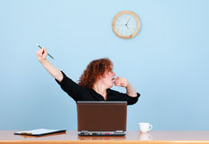 Tired businesswoman yawns and it lasts Stock Photography